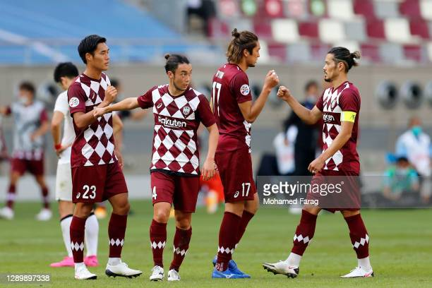Vissel Kobe's players celebrate their win during the AFC Champions League Round of 16 match between Vissel Kobe and Shanghai SIPG at the Khalifa...