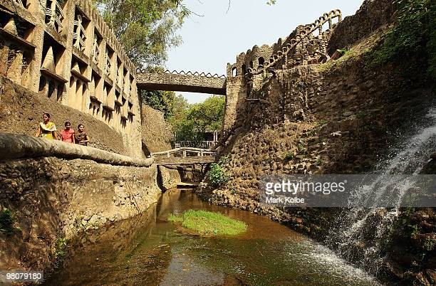 Vistors explore the Rock Garden on March 26 2010 in Chandigarh India The 12acre Rock Garden which began as secret project of Nek Chand in 1957 was...
