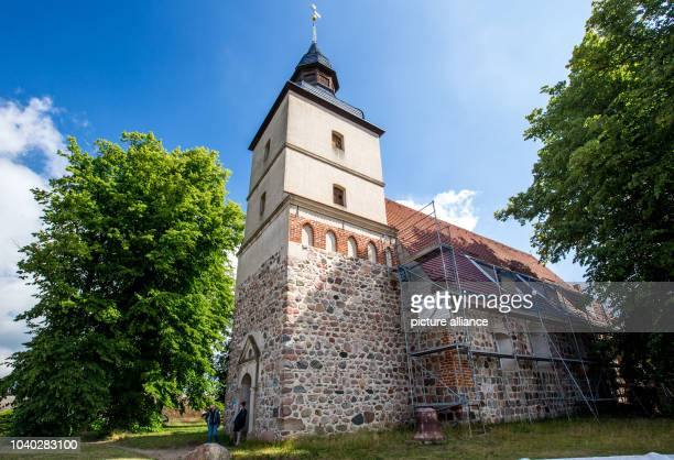 Vistors leave the village church of Benz Germany 18 June 2016 The church on the Baltic Sea island of Usedom was established in the 15th century A...
