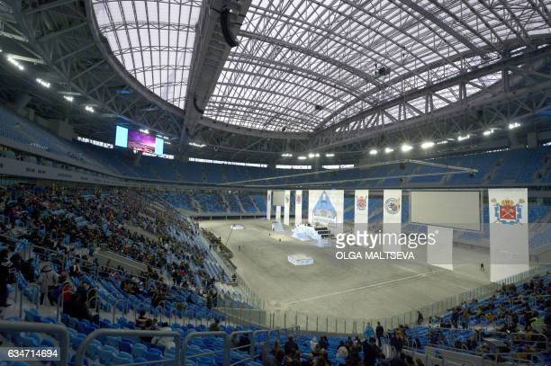 Vistors stand in the spectator area at the Krestovsky football stadium also known as Zenit Arena during a test of the venue in Saint Petersburg on...