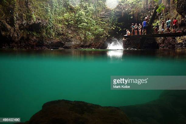 Vistors swim in the To Sua Ocean Trench on September 12 2015 in Lotofaga Samoa The To Sua Ocean Trench with a literal translation in English of...