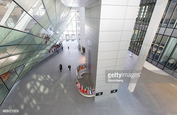 Vistors walk through the entrance hall inside the new headquarters of the European Central Bank in Frankfurt Germany on Friday Feb 13 2015 The ECB's...