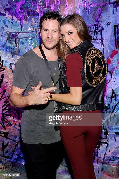 Visual artist Gregory Siff and model Alyssa Arce attend the MercedesBenz 2015 Evolution Tour on August 4 2015 in Los Angeles California