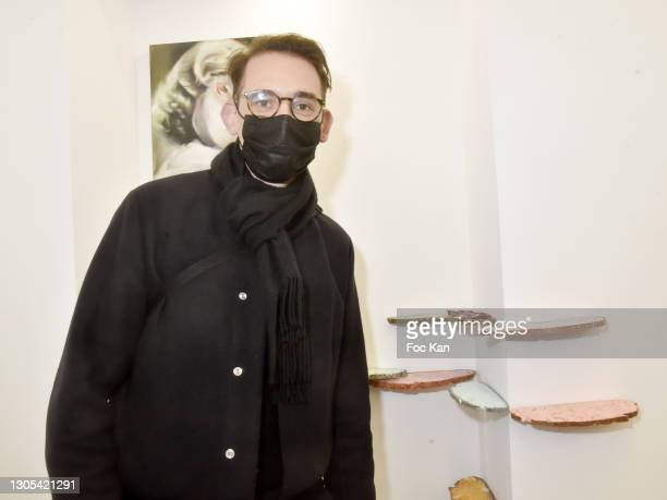 """Visual artist Vincent Olinet poses with his work during """"Ils Ont Dit Oui"""" Exhibition an Amalteo Institute Project Curated by Marc Molk at Galerie..."""