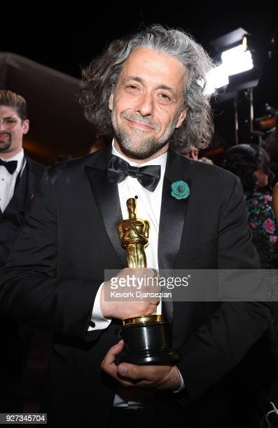 Visual effects artist Paul Lambert winner of the Best Visual Effects award for 'Blade Runner 2049' attends the 90th Annual Academy Awards Governors...