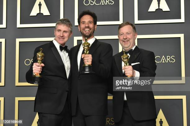 "Visual effects artists Dominic Tuohy, Guillaume Rocheron and Greg Butler, winners of the Visual Effects award for ""1917,"" pose in the press room..."