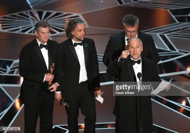 Visual effects artists Richard R Hoover Paul Lambert Gerd Nefzer and John Nelson accept Best Visual Effects for 'Blade Runner 2049' onstage during...