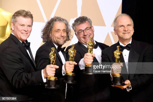 Visual effects artists Richard R Hoover Paul Lambert Gerd Nefzer and John Nelson winners of the Best Visual Effects award for 'Blade Runner 2049'...