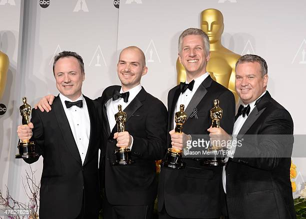 Visual effects artists Timothy Webber Neil Corbould Chris Lawrence and David Shirk winners of Best Achievement in Visual Effects pose in the press...