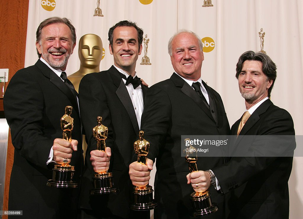 Visual effects director John Dykstra, Scott Stokdyk, Anthony LaMolinara and John Frazier pose with their 'Achievement In Visual Affects' for 'Spider-Man' backstage during the 77th Annual Academy Awards on February 27, 2005 at the Kodak Theater in Hollywood, California.