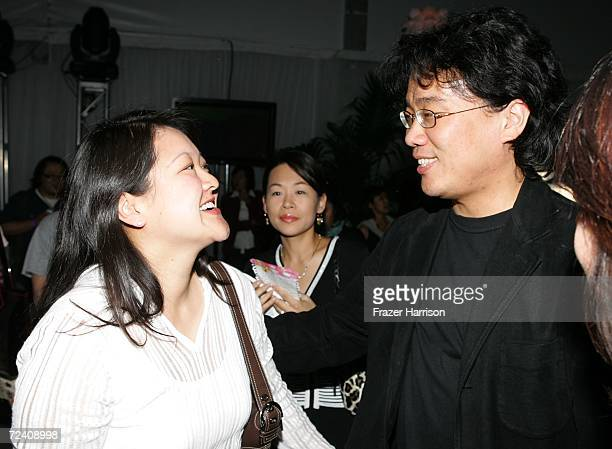 "Visual Effects producer Kymber Lim and writer/director Joon-ho Bong talk at the Audi party for ""The Host"" during AFI FEST 2006 presented by Audi held..."
