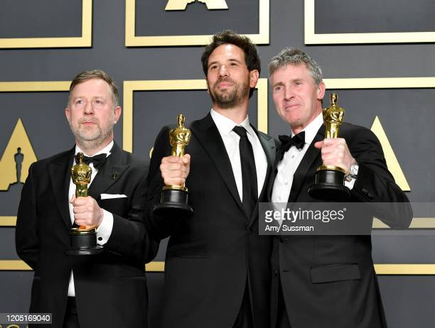 "Visual effects supervisors Guillaume Rocheron, Dominic Tuohy, and Greg Butler, winners of the Visual Effects award for ""1917,"" pose in the press room..."