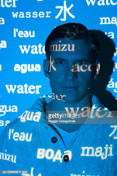 visual projection of pattern reading water in various languages cast on man, portrait - 映写 ストックフォトと画像