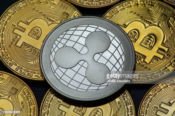 Visual representation of the cryptocurrencies Bitcoin and Ripple on November 20, 2018 in London, England. Cryptocurrencies including Bitcoin,...