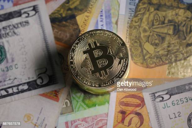 A visual representation of the digital Cryptocurrency Bitcoin alongside a selection of fiat currencies on December 07 2017 in London England...