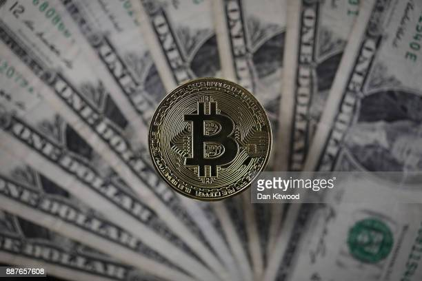 A visual representation of the digital Cryptocurrency Bitcoin alongside US Dollars on December 07 2017 in London England Cryptocurrencies including...
