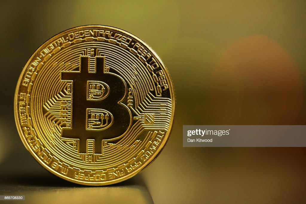 A visual representation of the digital Cryptocurrency, Bitcoin on October 23, 2017 in London, England. Cryptocurrencies including Bitcoin, Ethereum, and Lightcoin have seen unprecedented growth in 2017, despite remaining extremely volatile. While digital currencies across the board have divided opinion between financial institutions, and now have a market cap of around 175 Billion USD, the crypto sector coninues to grow, as it sees wider mainstreem adoption.