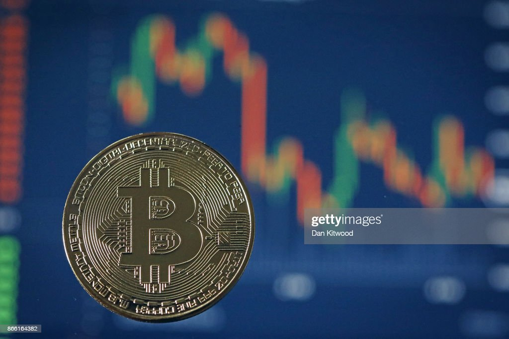 A visual representation of the digital Cryptocurrency, Bitcoin on October 24, 2017 in London, England. Cryptocurrencies including Bitcoin, Ethereum, and Lightcoin have seen unprecedented growth in 2017, despite remaining extremely volatile. While digital currencies across the board have divided opinion between financial institutions, and now have a market cap of around 175 Billion USD, the crypto sector coninues to grow, as it sees wider mainstreem adoption.