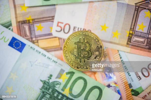 A visual representation of the digital Cryptocurrency Bitcoin with Euro bill on December 13 2017 in Hong Kong Hong Kong The price of Bitcoin has seen...