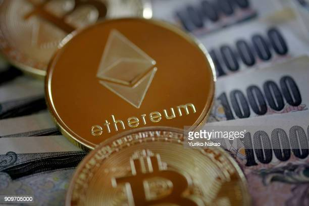 THE HAGUE NETHERLANDS JANUARY 13 2018 Visual representations of cryptocurrency Ethereum and Bitcoins are placed on Japanese 10000 yen notes in this...