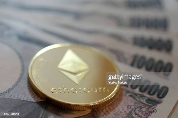 THE HAGUE NETHERLANDS JANUARY 13 2018 A visual representations of cryptocurrency Ethereum is seen on Japanese 10000 yen notes in this photo...