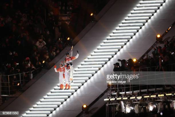 Visually impaired athlete Yang Jae Rim and guide Go Eun Sori hands over the torch to Han Min Su during the opening ceremony of the PyeongChang 2018...