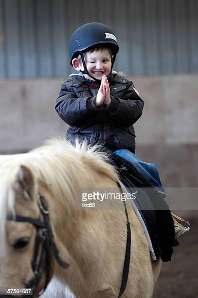 Visually impaired boy enjoying horseriding lesson