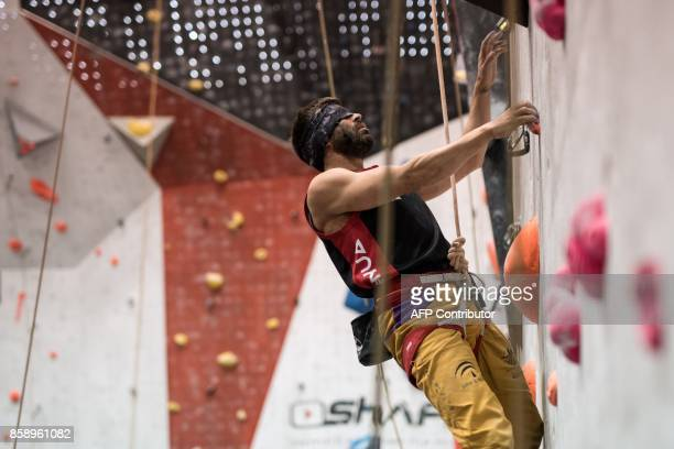 Visually impaired climber Javier Aguilar Amoedo of Spain competes in the English stage of the IFSC Paraclimbing Cup at the Awesome Walls climbing...