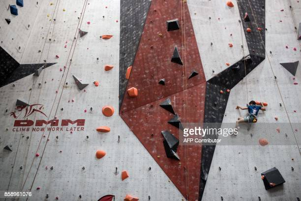 Visually impaired climber Roxane Heili of France competes in the English stage of the IFSC Paraclimbing Cup at the Awesome Walls climbing centre in...