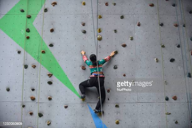 Visually impaired girl tries to climb wall in Astrek Climbing wall at Thamel, Kathmandu, Nepal on Wednesday, March 31, 2021. First-ever wall climbing...