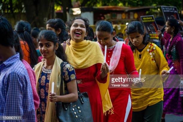 Visually impaired girls hold candles during a protest demonstration on international women's day on March 08 2020 in New Delhi India Dozens of...