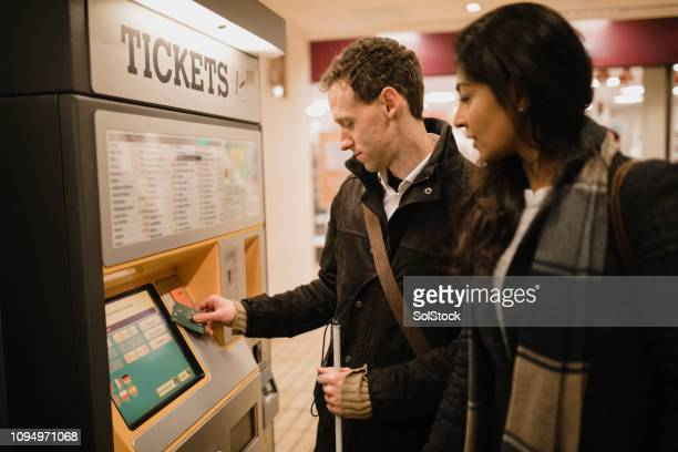 visually impaired man making a card payment - blindness stock pictures, royalty-free photos & images