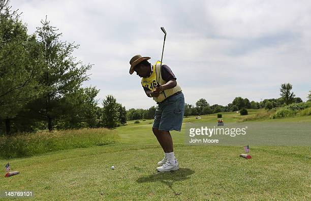 Visually impaired military veteran Wilber Eugene tees off during the golf competition of the National Golden Age Games on June 3 2012 in Alton IL...
