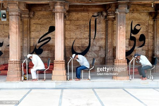 Visually impaired Muslim devotees offer Namaz prayers at Shahi Jam-e-Masjid after the government eased a lockdown imposed as a preventive measure...