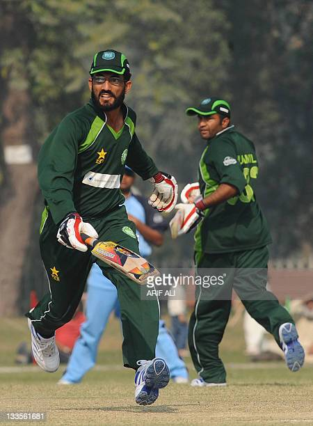 Visually impaired Pakistani cricketers Masood Jan and Muhammad Jamil run between the wicket during the International Twenty20 match between Pakistan...