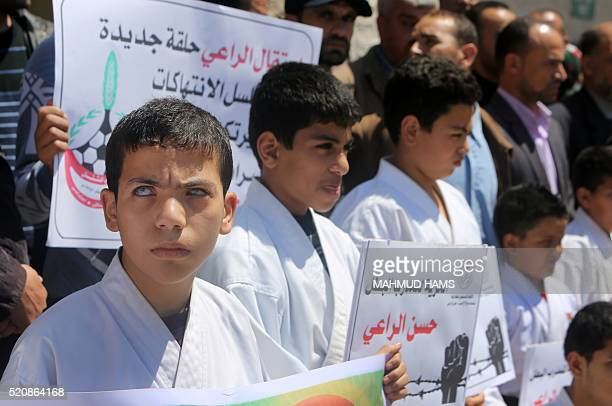Visually impaired Palestinian youths hold placards during a protest of the members of a blind karate team outside the Red Crescent offices in Gaza...
