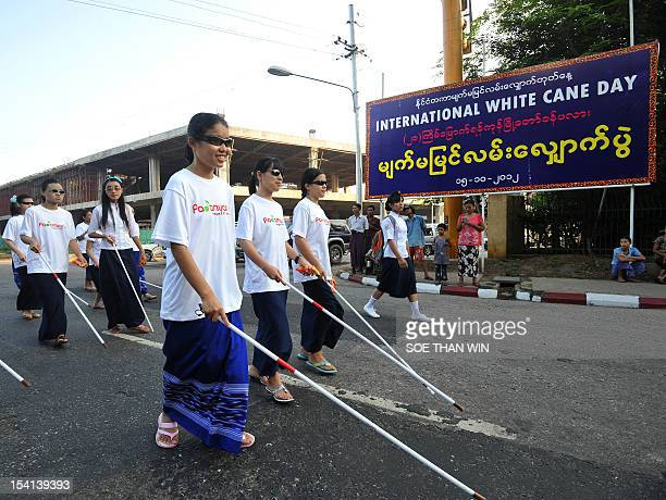 Visually impaired people take part in the White Cane Safety Day in Yangon on October 15 2012 White Cane Safety Day is a national observance in the US...