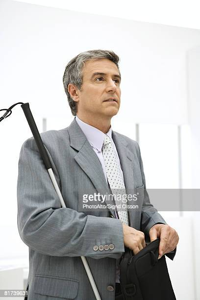 Visually impaired professional man holding briefcase