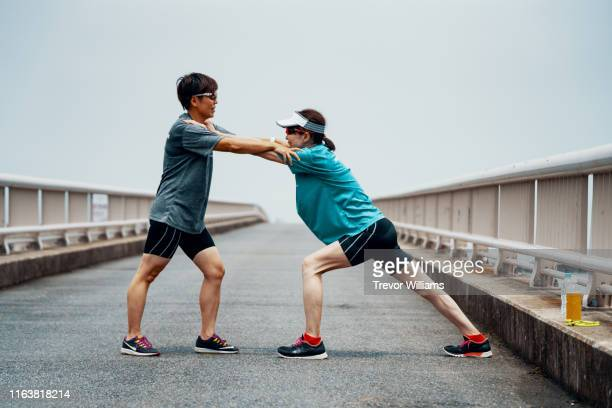 visually impaired sportsperson with her coach - partially sighted stock pictures, royalty-free photos & images
