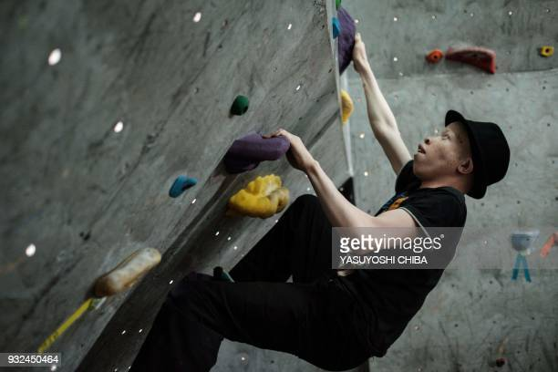 TOPSHOT A visually impaired student challenges bouldering during a weeklong free climbing training for visually impaired and blind students by the...