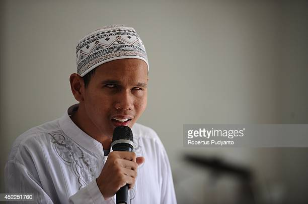 A visually impaired student prays at The Foundation for The Education of Blind Children during Ramadan on July 17 2014 in Surabaya Indonesia Braille...
