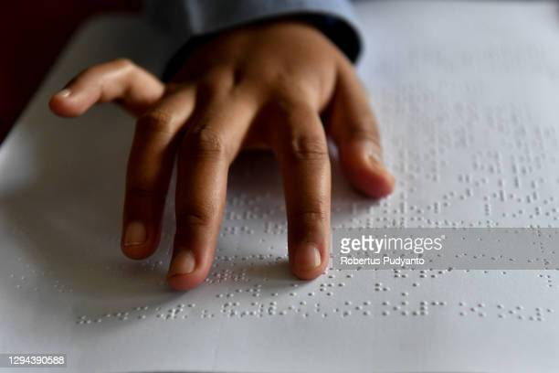 Visually impaired student reads Braille during an online class on World Braille Day on January 04, 2021 in Surabaya, Indonesia. World Braille Day...