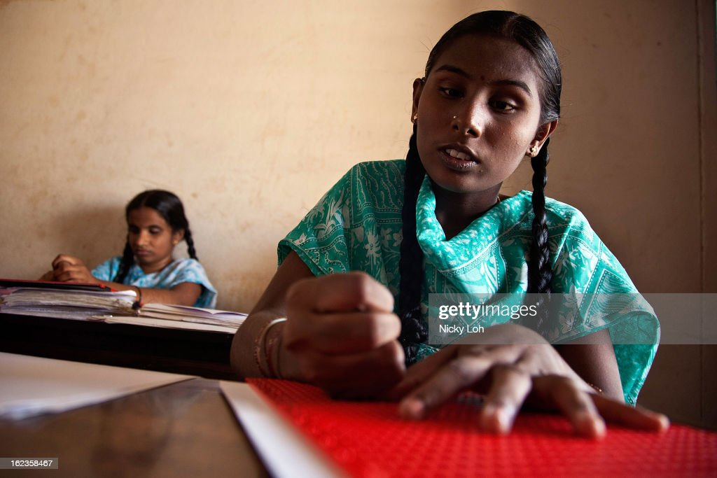 A visually impaired student writes in Braille with a slate at the Government High School for The Blind on February 22, 2013 in Kadapa, India. The school which is funded by the government looks after 50 visually impaired or blind students. India has the largest number of people with visual impairment globally. According to the World Health Organization (WHO), an estimated 63 million people in India are visually impaired, and of these approximately 8 million people are blind.