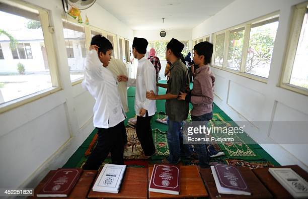 Visually impaired students attend to Ramadan class at The Foundation for The Education of Blind Children on July 17 2014 in Surabaya Indonesia...