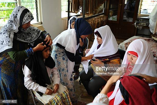 Visually impaired students take part in Ramadan class at The Foundation for The Education of Blind Children on July 17 2014 in Surabaya Indonesia...