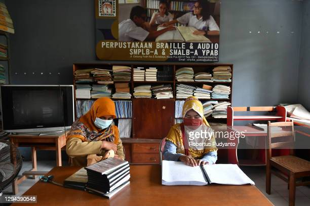 Visually impaired teachers read Braille book during World Braille Day on January 04, 2021 in Surabaya, Indonesia. World Braille Day 2021, which is...