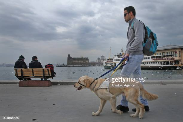 Visually impaired Yusuf Ucar who studies at Department of Sport Management of Istanbul University's Faculty of Sport Sciences walks with his guide...