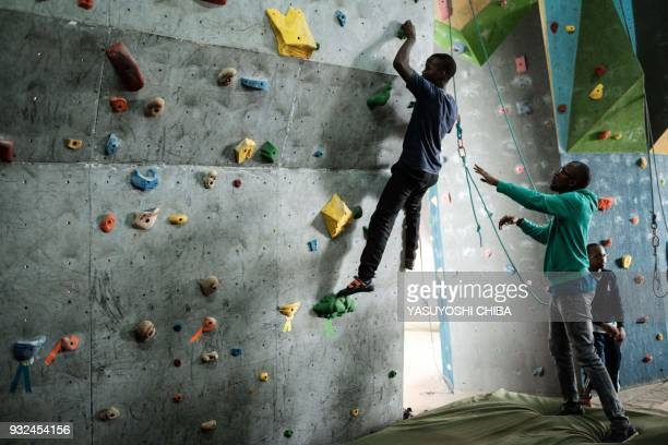 TOPSHOT A visually impared student challenges bouldering during a weeklong free climbing training for visually impaired and blind students by the...