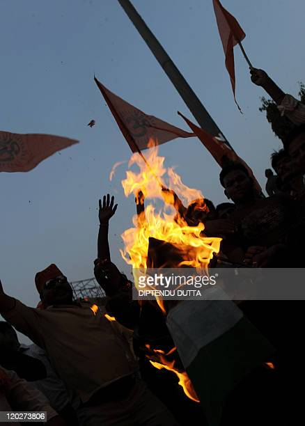 Viswa Hindu Parishad supporters burn a Pakistani flag to celebrate the death sentence of Mohammed Ajmal Amir Kasab in Allahabad on May 6 2010 The...