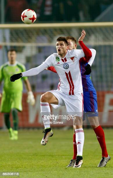 Vit Benes of Vasas FC battles for the ball in the air with Tamas Takacs of DVSC during the Hungarian OTP Bank Liga match between Vasas FC and DVSC at...